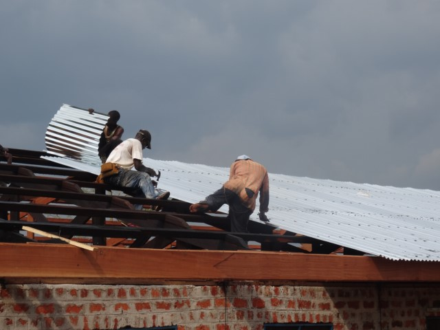 roof repairs metal roof- Sept 17- nailing new roofing [640x480].JPG