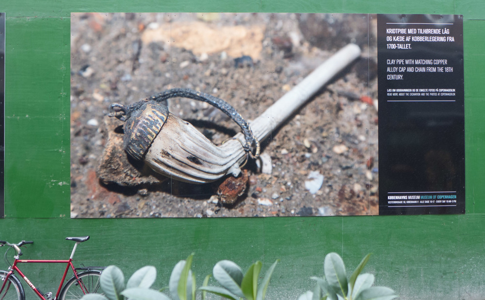 Photograph on the hoardings around engineering work for the extension to the Metro showing finds from Gammel Strand