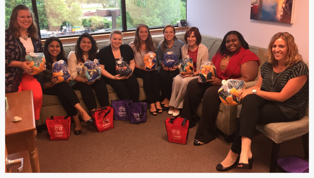 Center for Assessment and Treatment staff with stuffed bears donated from Jayme's Fund for Social Justice.