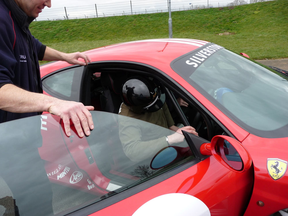 The Writing Man climbs inside his Ferrari 360 Modena