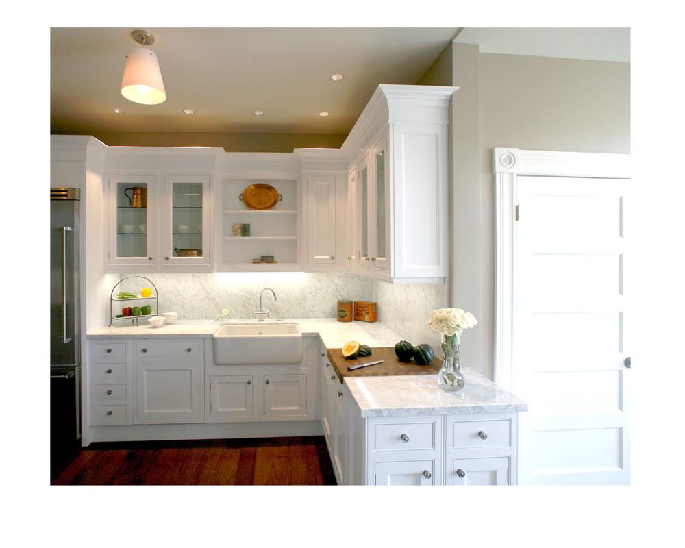 Kitchen and bath showroom with custom kitchen island also white quartz