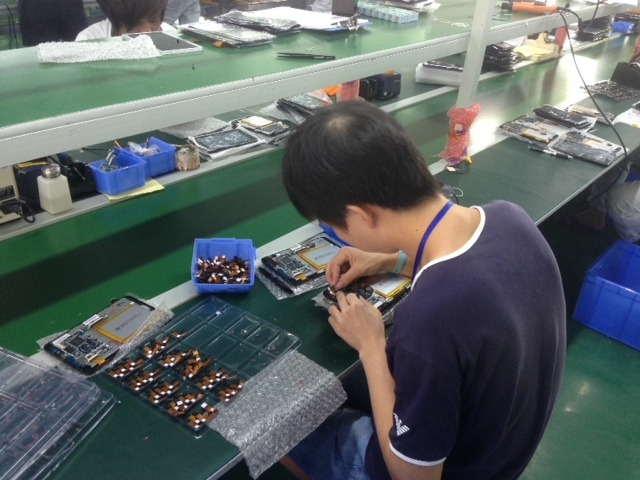 ODIN's Assembly Plant in December - (worker is making a tablet right now)