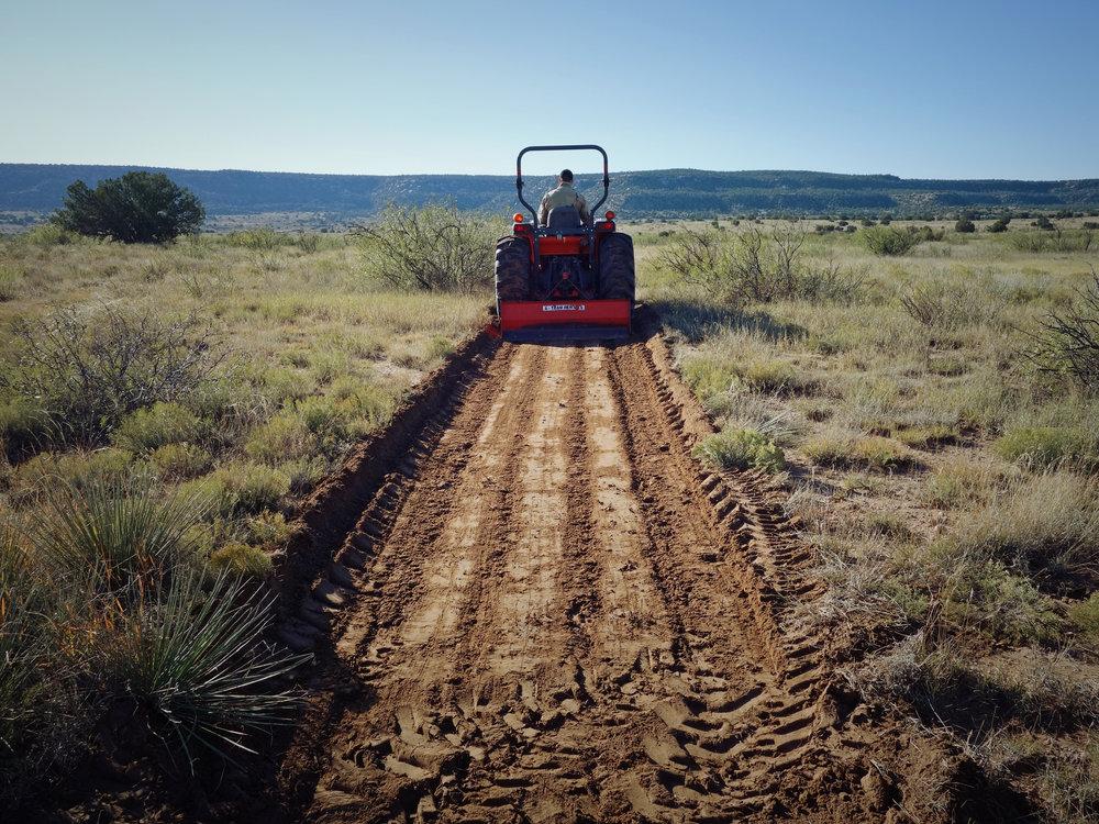 Excavating a half-mile driveway.