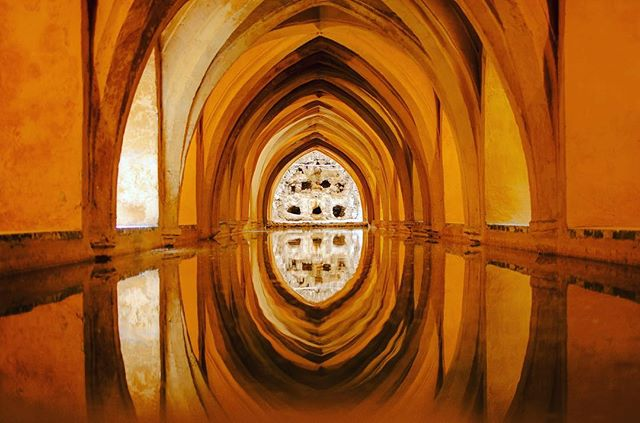"Reflection of the aqueduct in water. Alcazar de Seville, Spain. C. 2012. [nikon D50] Sir Edmund Hillary once said, ""it is not the mountain we conquer, but ourselves."" I've always found that to be true of all new journeys, including this one that had started with nothing but a one way ticket to Spain, veered through Portugal, and brought me back to myself in 2012. #travel #travelphotography #photography #travel #spain #seville #water #reflection"