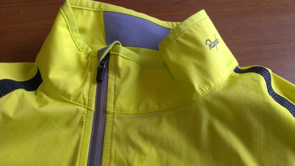 Offset waterproof zipper and shoulder seam reinforcement