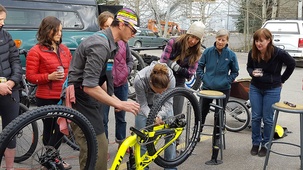 Attendees learn how to fix a flat