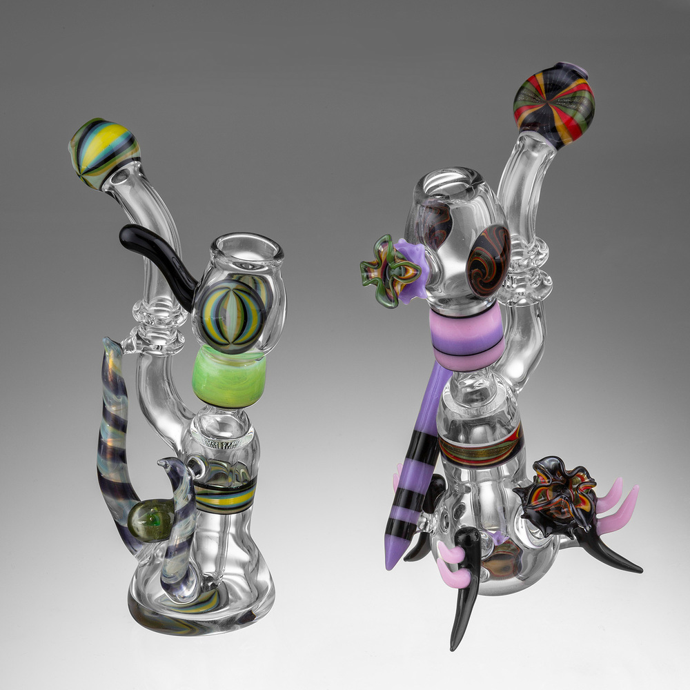 two multicolored glass pipes on a gradient background by eugene photographer john higby