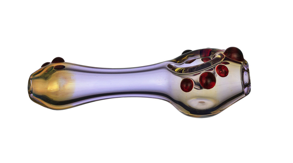 purple & yellow glass pipe on a white background photographed by eugene photographer john higby