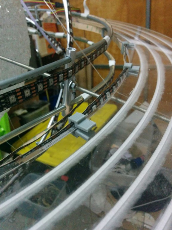 Custom clips had to be designed and 3D printed to hold the LED strips to the perspex ring