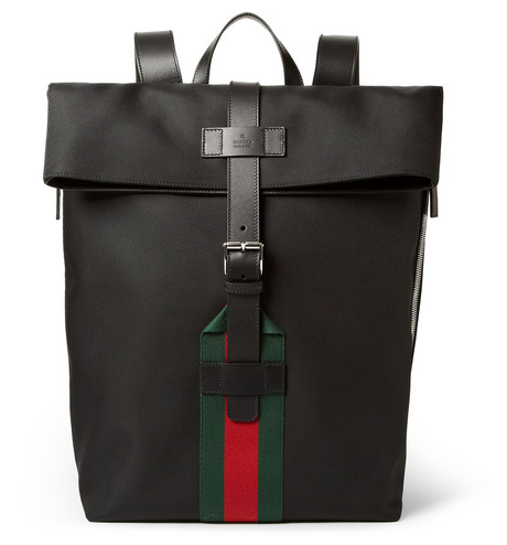 GUCCI  LEATHER-TRIMMED CANVAS BACKPACK $990