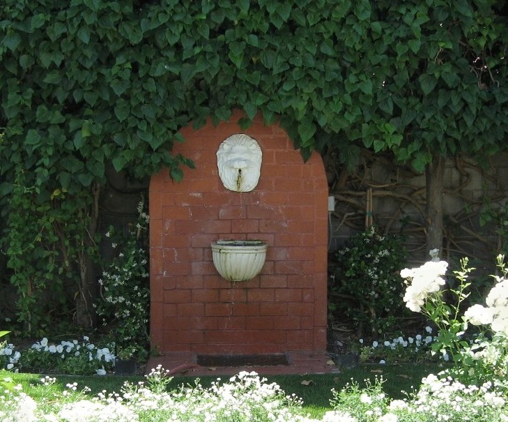 Brick and stone wall fountain