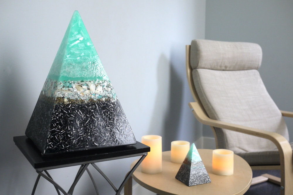 Oceanic themed orgone pyramid for Mill Creek Float in Mill Creek, WA. 2017. This device along with 3 smaller pyramids were created with the intent to enhance customers sensory deprivation floating experience. Certain crystals and minerals were selected with metaphysical properties for grounding, transmuting negative energy, relaxation and higher consciousness.