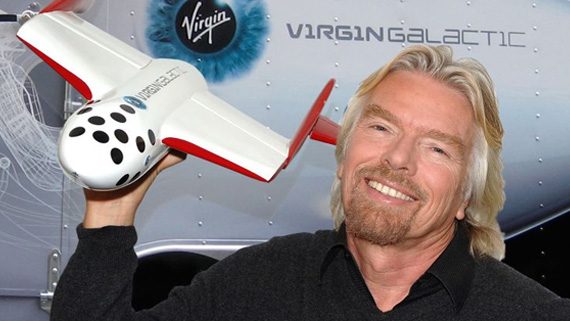 Richard Branson posing with a  model space plan in 2004, when he promised that Virgin Galactic's first flight would be within a year. Haha, good one, Richard.