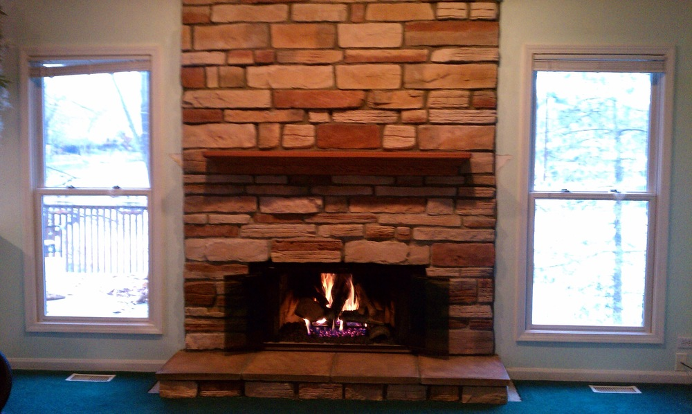 Wood Burning Fireplace w/ Stone Work, Mantel, Glass Doors and Gas Logs