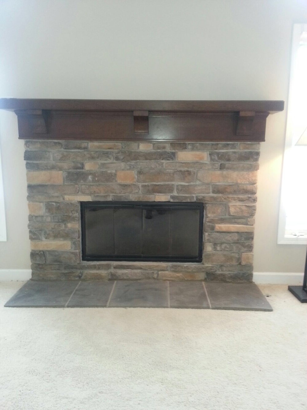 Wood Burning Fireplace w/ Stone Work, Glass Doors and Mantel