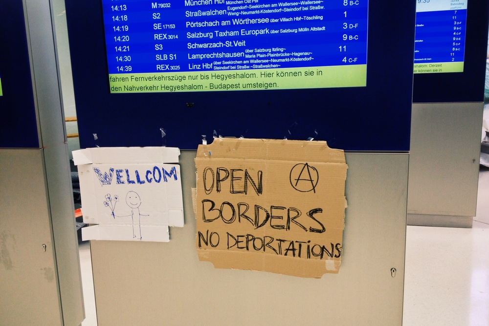 Two of the many, many signs displaying public support for the refugees arriving in Europe.