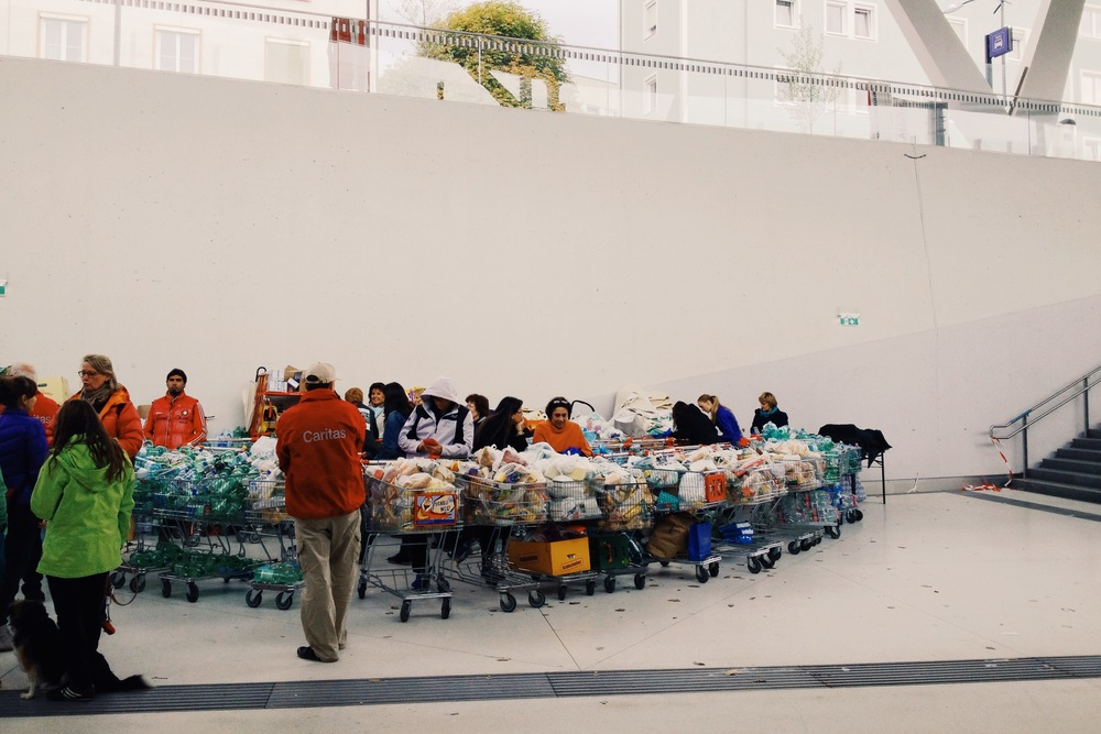 Volunteers waiting with food and water in the Salzburg train station for the next wave of refugees to arrive.