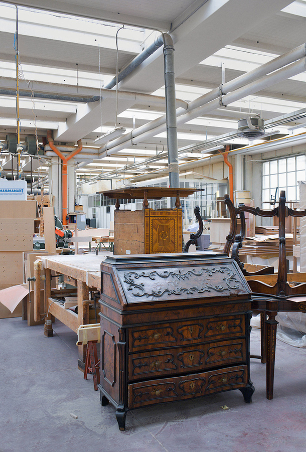 Antique furniture waiting to be restored in the Annibale Colombo factory