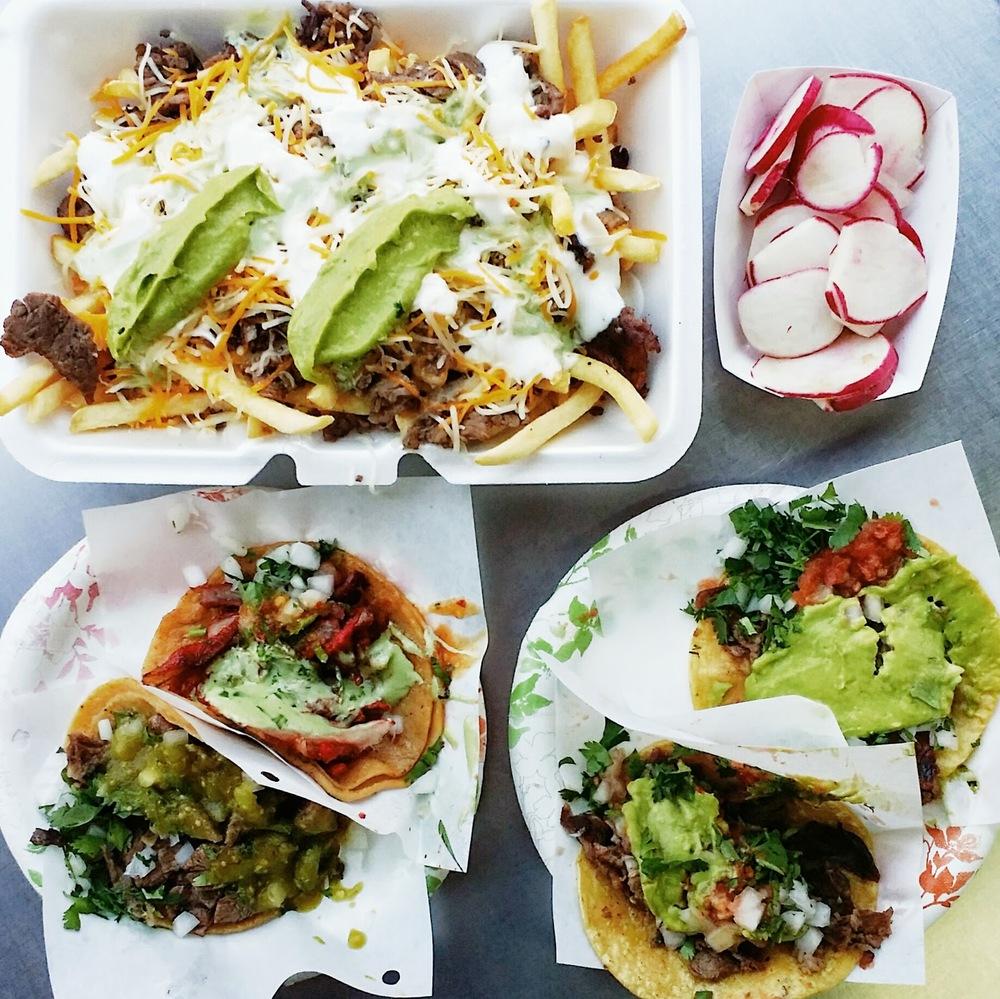 {Carne asada fries, al pastor taco, lengua taco, & carne asada tacos}