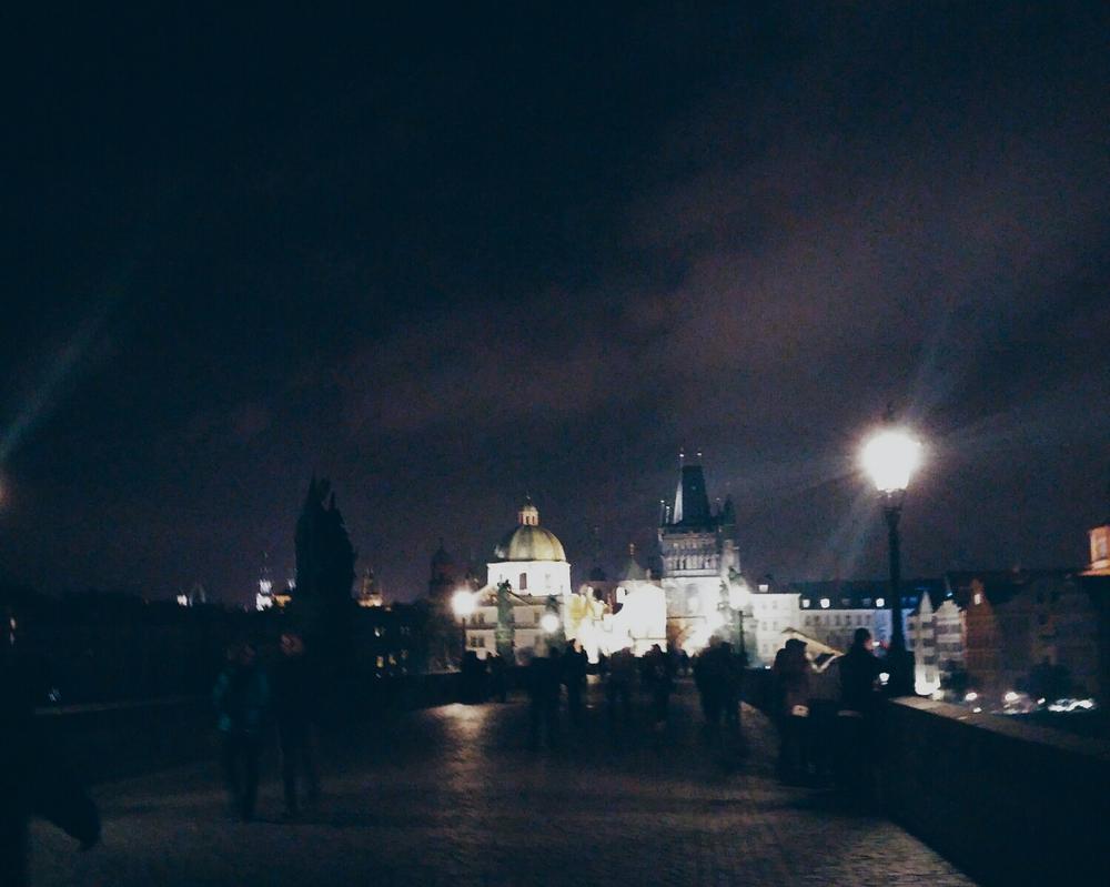 {Charles Bridge at night.}