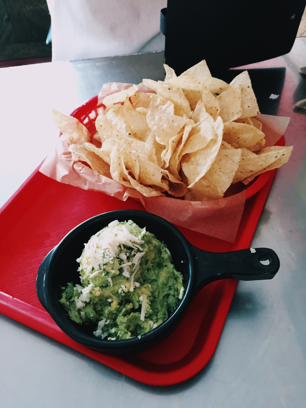 {chips and guacamole at torchy's tacos.}