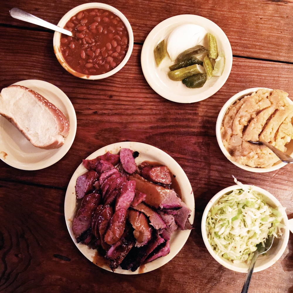 {bread, baked beans, onions & pickles, potato salad, cole slaw, and bbq.}