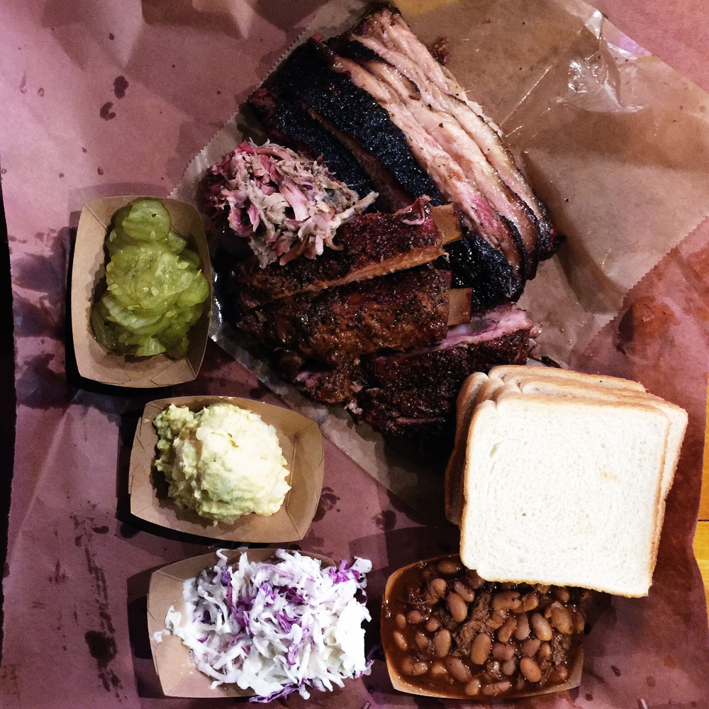 {brisket, ribs, pulled pork, pickles, pinto beans, coleslaw, & potato salad.}