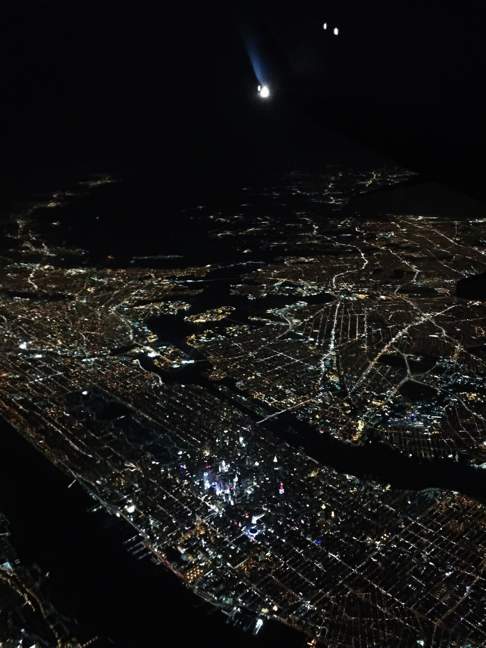 {and helloooo, nyc. look closely, and you can see central park & the empire state building.}