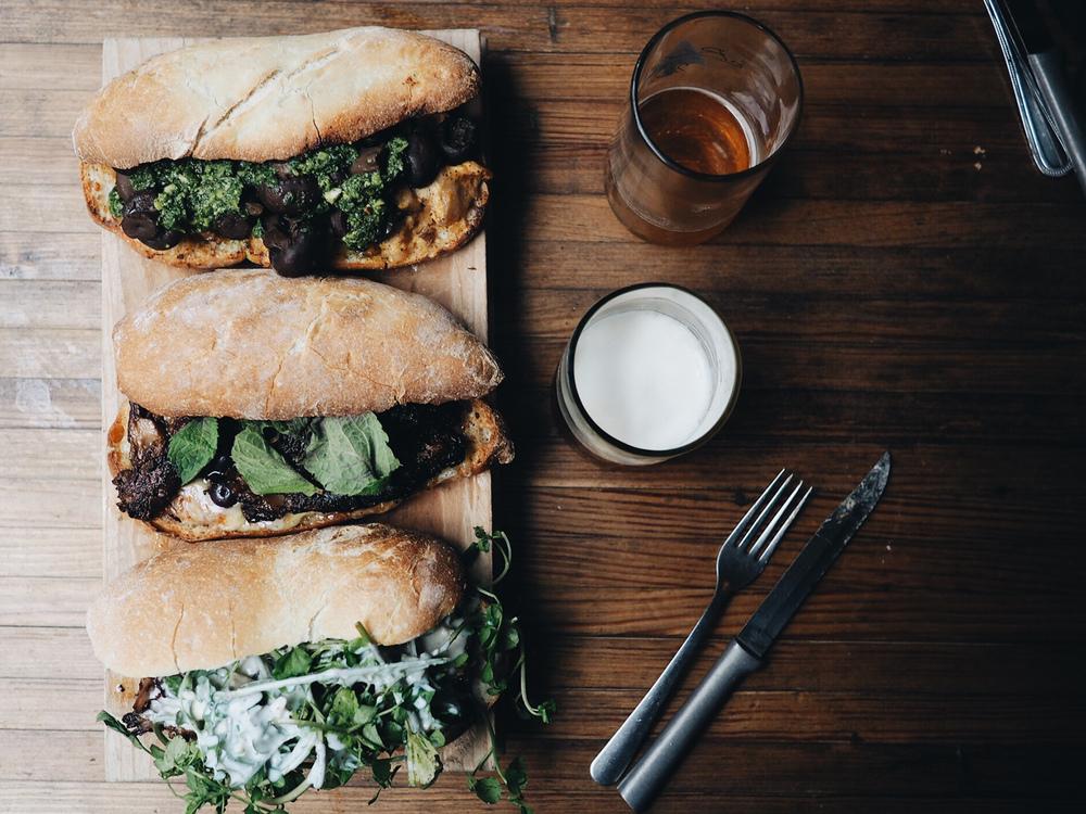 {Sandwiches & beers. Top to bottom: Summer Mushroom, HeirloomPig, Short Rib.}
