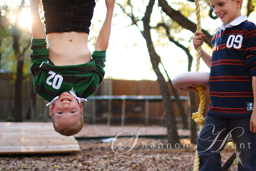 brothers on playground by Temple TX photographer