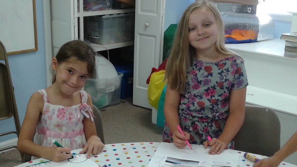 Sarah and Charlotte working on their cards for Captain Buzz.