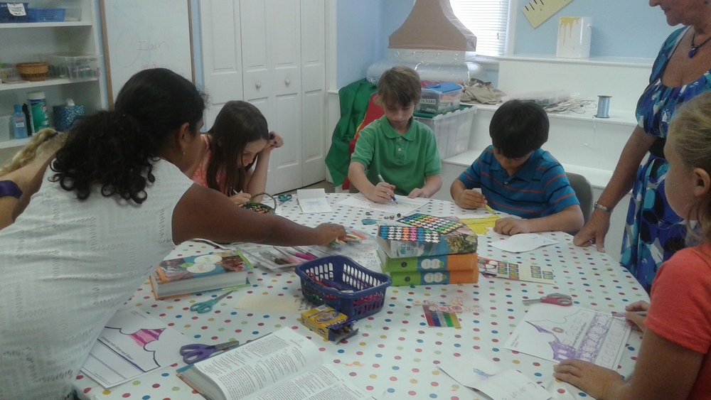 4th & 5th graders reading Scripture.