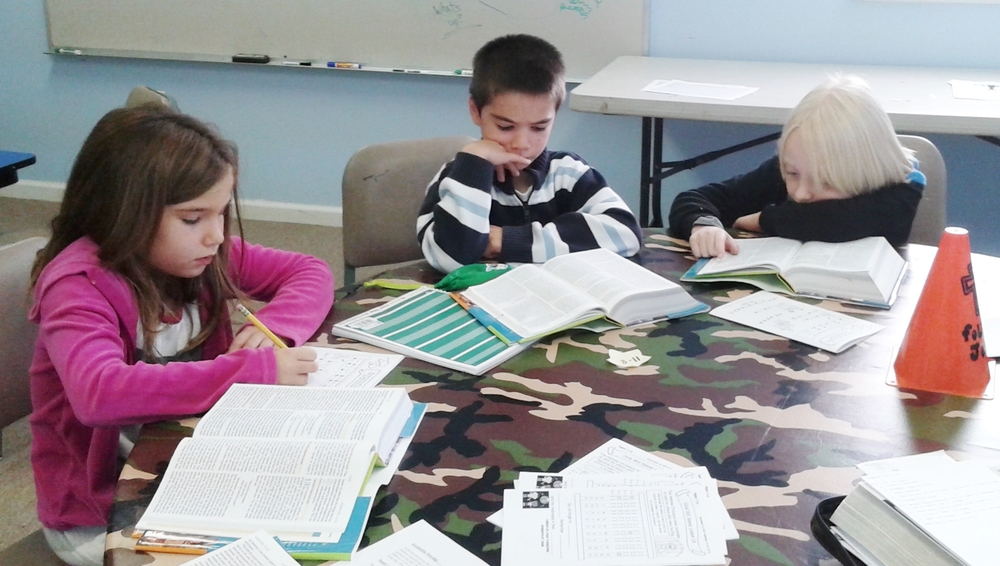 2ND & 3RD GRADE CLASS STUDYING THEIR BIBLE