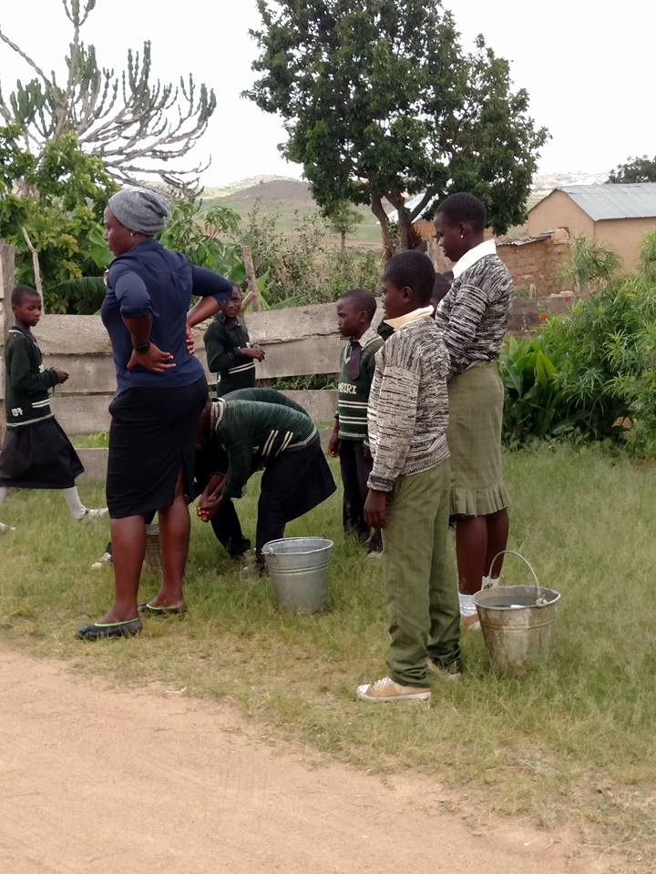 Washing their hands before lunch