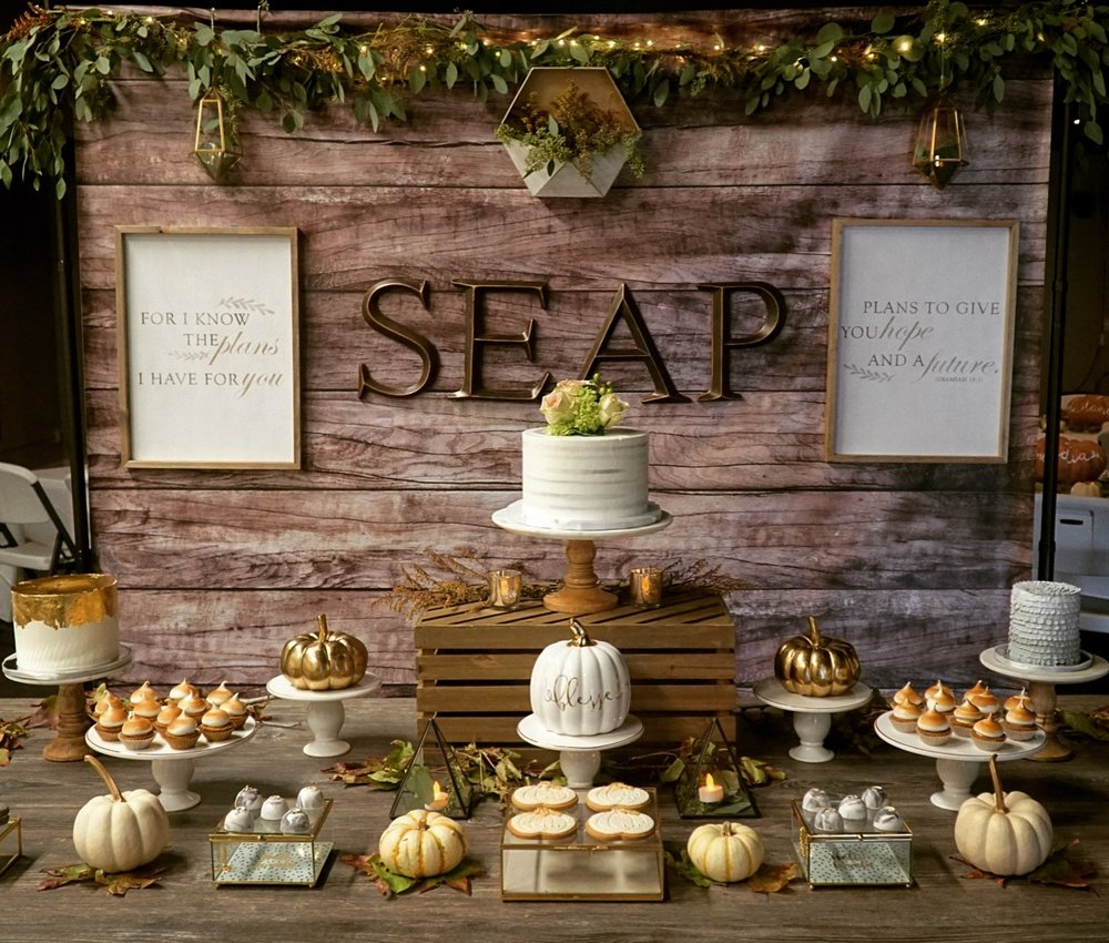 The dessert bar set up with custom made cookies by Jenteebakes and fall cakes by Sweet and Saucy were divine and beautiful.