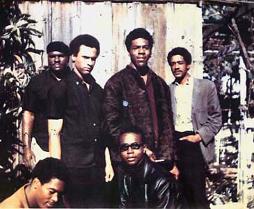 "Top: Elbert ""Big Man"" Howard, Huey P. Newton (Defense Minister), Sherwin Forte, Bobby Seale (Chairman) Bottom: Reggie Forte and Bobby Hutton (Treasurer)."