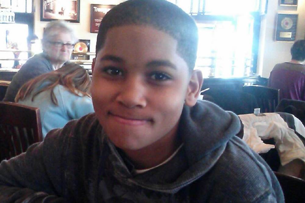 "UPDATED JUN. 15, 2015 Tamir Rice was only 12-years-old when we was shot and killed by Cleveland Ohio police officers, on sight, when they arrived at Cudell Recreation Center on November 22, 2014 following a 911 call where the inquired twice whether the subject was Black or white.  Rice was described by an onlooker as ""a male black sitting on a swing and pointing a gun at people."" The caller then goes on to state that he thinks Tamir Rice is ""probably a juvenile"" and also includes that he thinks the gun is ""probably fake"" twice. When officers 26-year-old Timothy Loehmann and 46-year-old Frank Garmback arrived at the park Loehman proceeded to discharge his weapon twice before their squad car stopped moving striking Rice once in the torso. Both officers neglected to administer the appropriate first aid to Rice after inflicting his fatal injury. It would later be discovered that, before joining the Cleveland Police Department, Timothy Loehmann has been declared unstable and unfit for service by his former department in Independence Ohio.  Video footage released also reveal that Tamir's 14-year-old sister was detained after rushing to her brother's side at the scene. On June 3, 2015 the Cuyahoga County Sheriff's Office stated that their investigation had come to a conclusion. However, to this day Cuyahoga County Prosecutor Timothy McGinty has not publicly reached a decision to present evidence to a grand jury for indictment.       The Rice family has since filed a wrongful death claim against both officers and the City of Cleveland. A decision in their case is still pending."