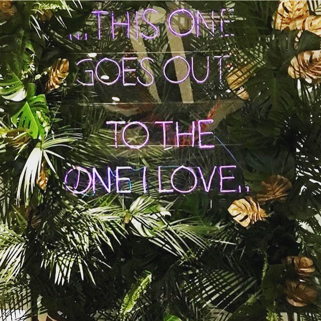 A quick shot of our plant wall with custom EL wire signs from this weekend #monsteramonday #djbackdrop #plantwall #weddingdecor #newseumwedding #dcwedding #thisonegoesouttotheoneilove