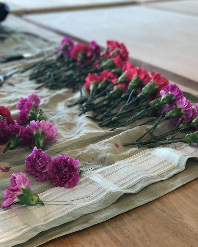 BTS prep of our floral ceiling last weekend at the @newseum // fuschia and pink carnations + greens = 😻