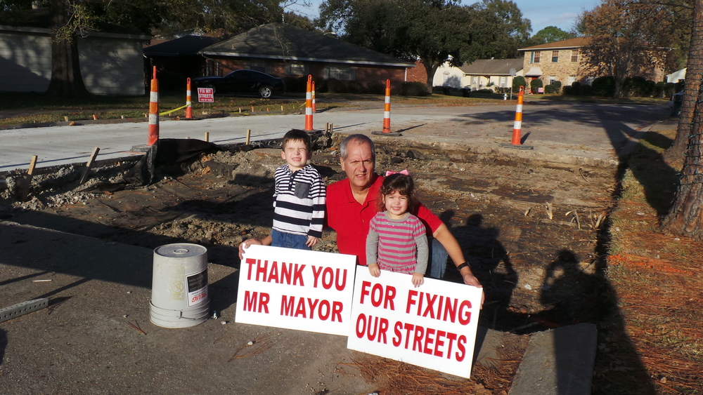 Fix My Streets Board Member, Eric Songy and his two grandchildren in the Bocage neighborhood of Algiers.