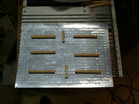 Showing all 609 holes in the aluminum platen along with spacers that have been glued into position.