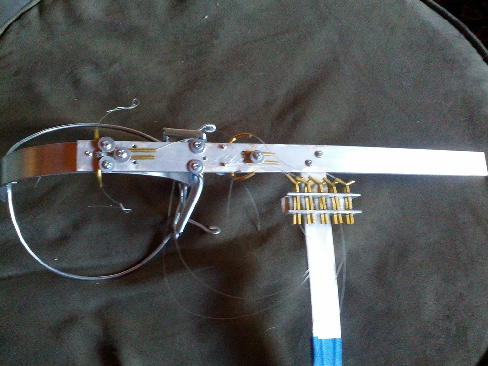 Back of the eye mechanism showing the brass routing tubes and the control wire manifold