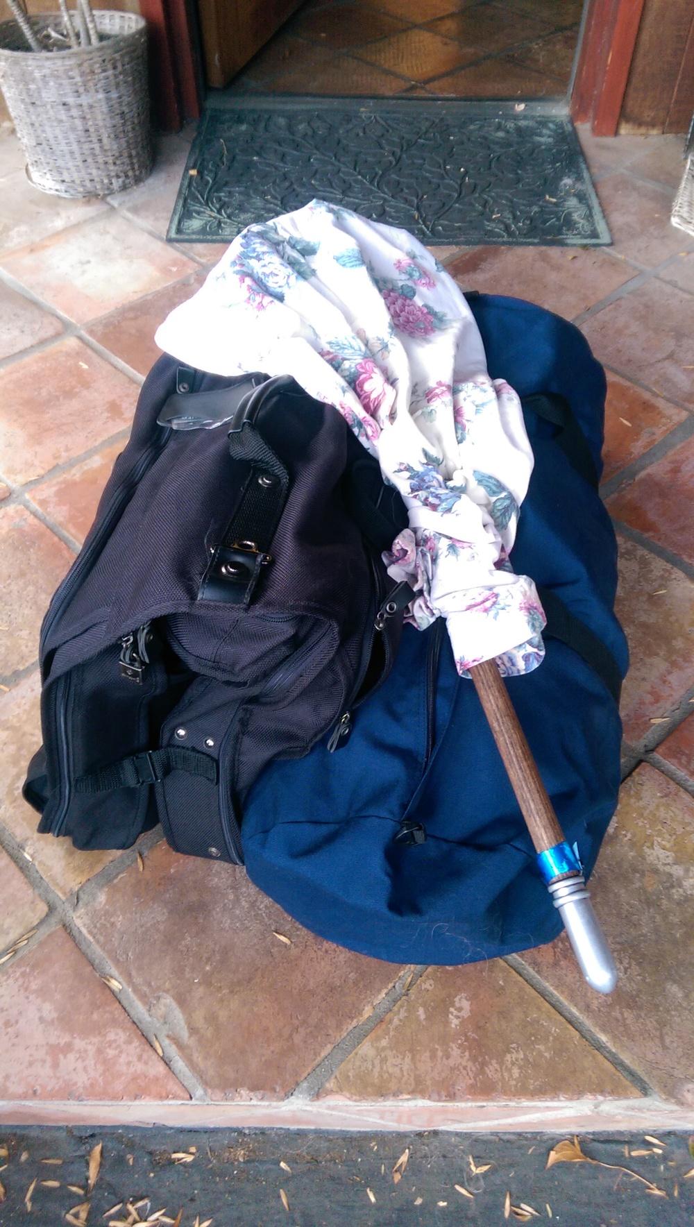 Headless Horseman divided between a garment bag and a smaller duffel bag