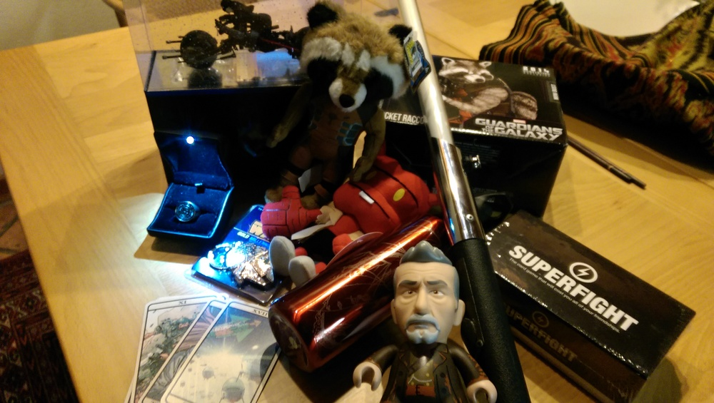 This is just a representative sample of the stuff I brought back. Statues, plushies, models, key chains, reproductions, lightsaber, cards, games, and yup, that's a water bottle.