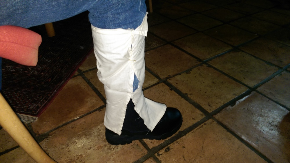 Test fitting the gaiters over my pants leg and the boot, indicating adjustments that needed to be made