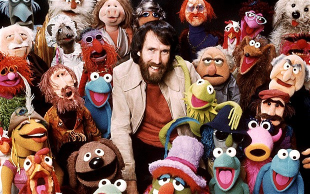 Jim Henson surrounded by the Muppets he created
