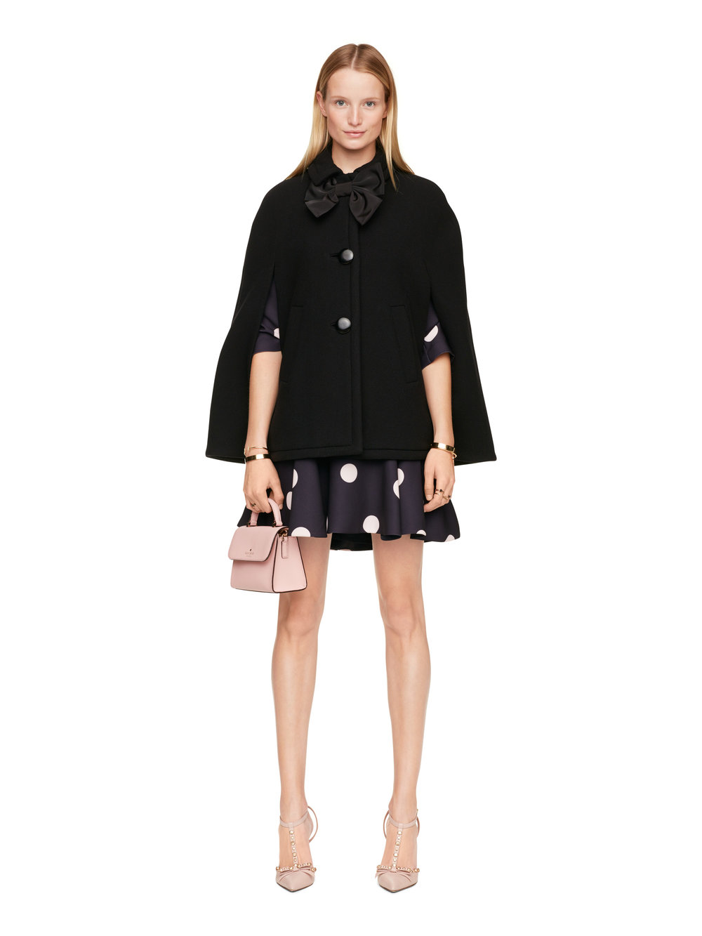 Kate Spade black cape with bow fastening.