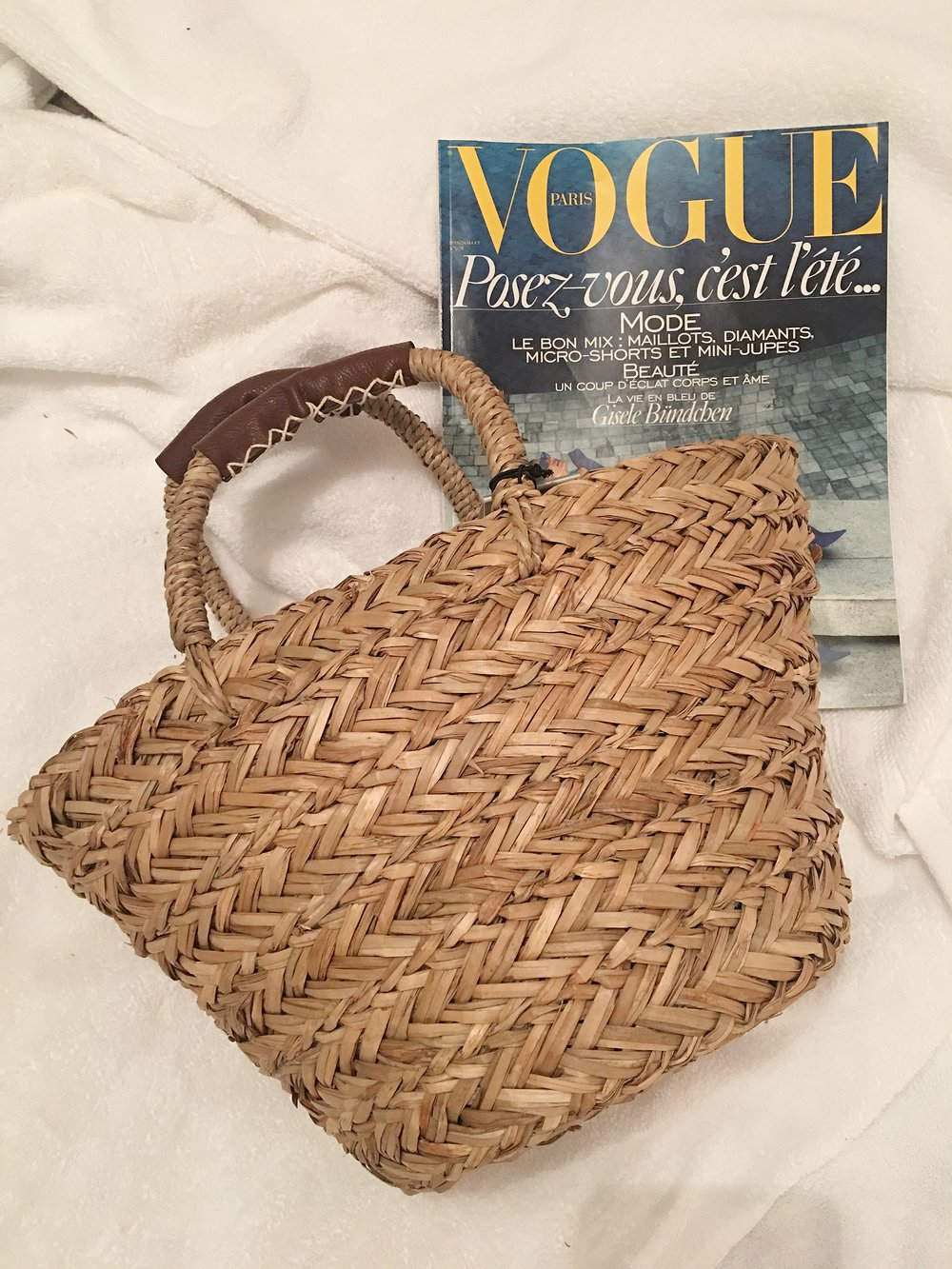 An itsy bitsy teeny weeny hand woven beach basket from The Quintessential. All of my favourite style bloggers have one! And a copy of Vogue Paris... if you're as pretentious as me you can have it too! 🙌🏻