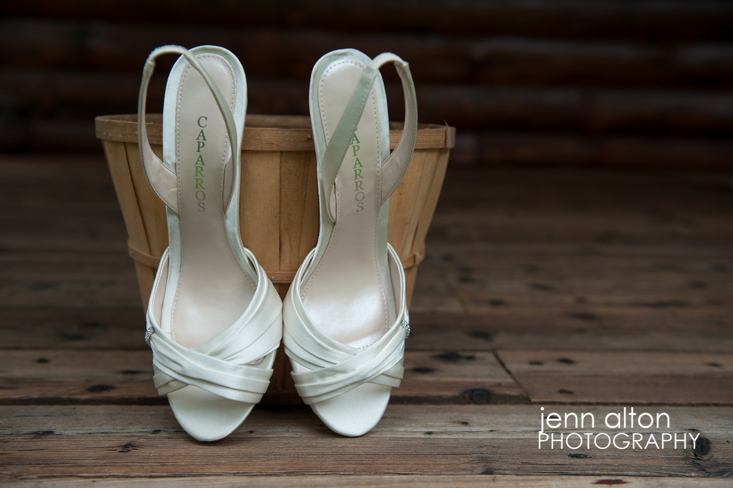 Bride's shoes detail, with apple bucket and wood porch