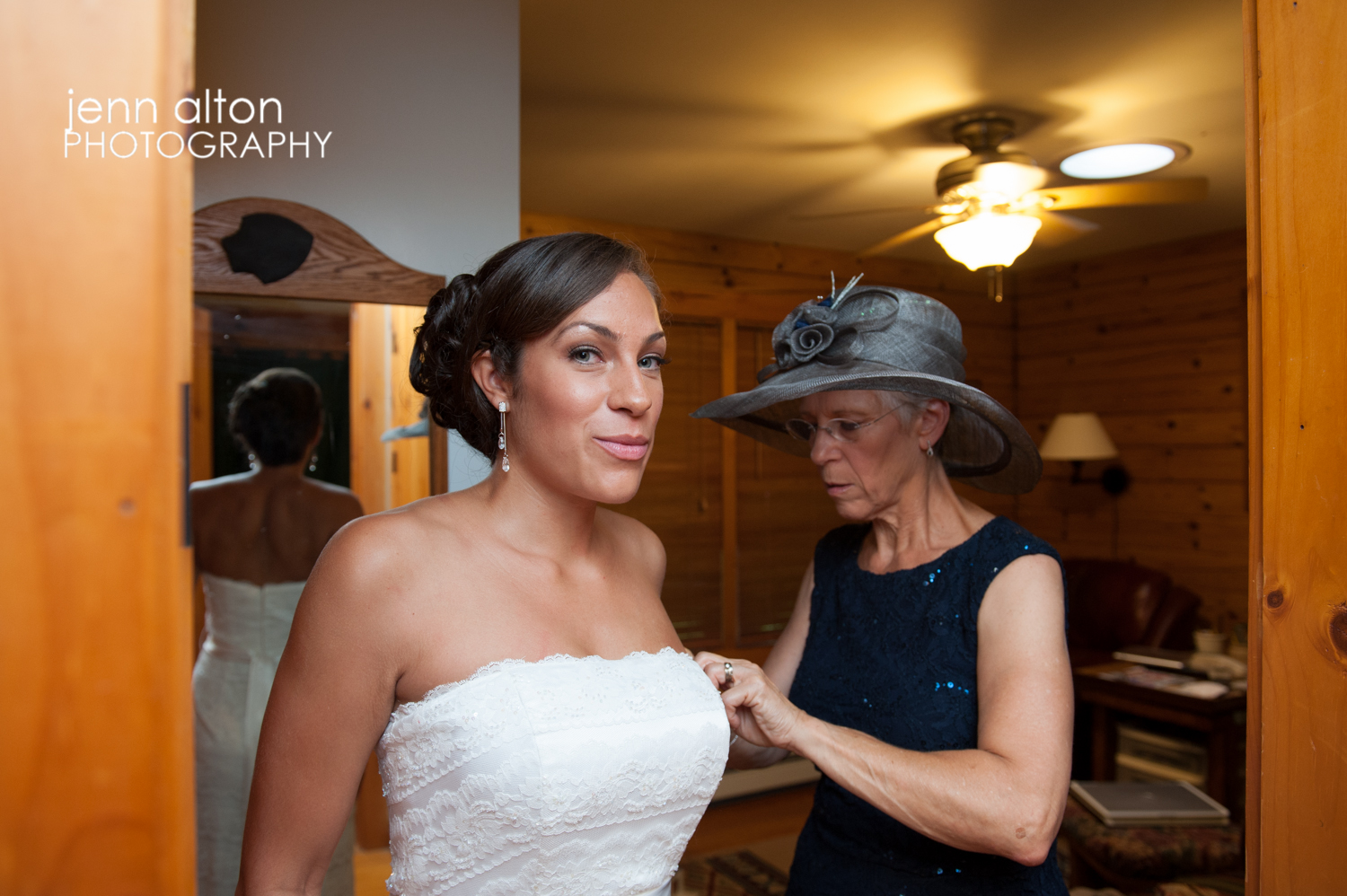 Bride getting into wedding gown with the help of her Mother, Cape Cod Wedding